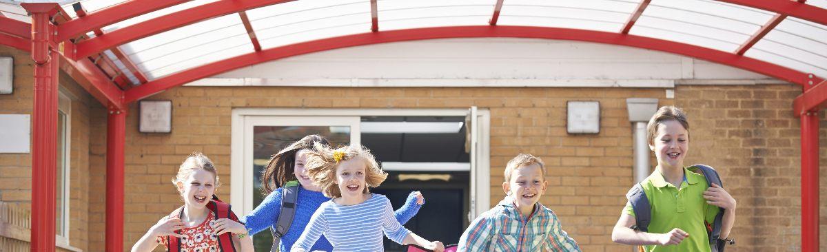 School Pupils Running in Playground